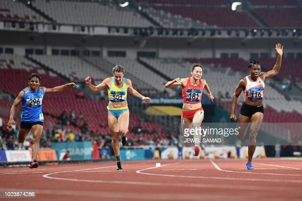 India's Dutee Chand Kazakhstan's Olga Safronova China's Wei Yongli and Bahrain's Edidiong Odiong compete in the final of the women's 100m athletics...