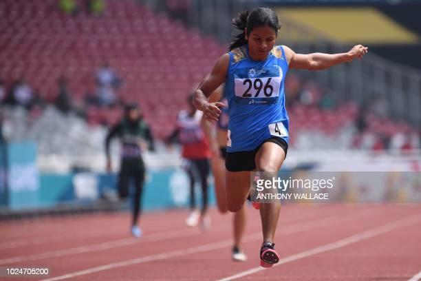 India's Dutee Chand wins the heat of the women's 200m athletics event during the 2018 Asian Games in Jakarta on August 28 2018