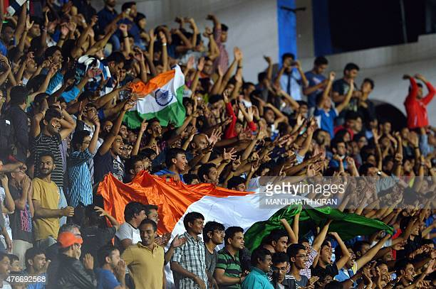 India's fans cheer after their team scored a goal during the Asia Group D FIFA World Cup 2018 qualifying football match between India and Oman at...