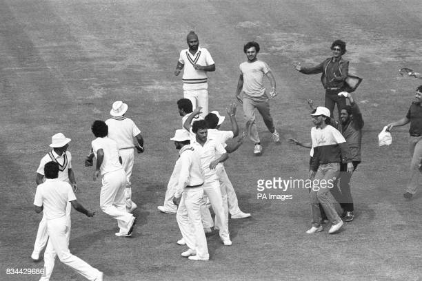 India's fans invade the pitch during the final at Lord's after Xapil Dev caught West Indian Viv Richards for 33 off the bowling of Madan Lal Earlier...
