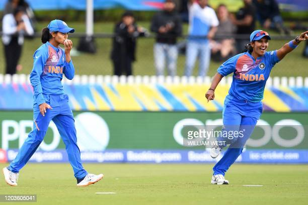 India's fielder Radha Yadav celebrates the successful catch to dismiss New Zealand's Sophie Devine during the Twenty20 women's World Cup cricket...