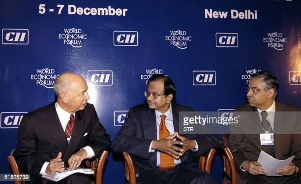India's Finance Minister Palaniappan Chidambaram speaks with World Economic Forum Chairman Klaus Schwab L and Hero Honda Managing Director Sunil Kant...