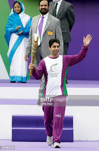 India's first individual Olympic Gold medallist and world champion air rifle shooter Abhinav Bindra starts the baton run watched by Britain's Queen...