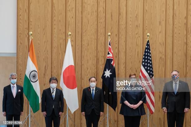 India's Foreign Minister Subrahmanyam Jaishankar, Japan's Foreign Minister Toshimitsu Motegi, Japan's Prime Minister Yoshihide Suga, Australia's...