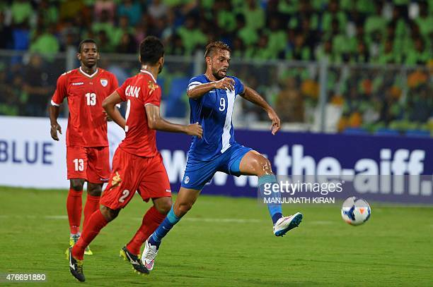 India's forward Robin Singh controls the ball next to Oman's defender Mohammed AlMusalami during the Asia Group D FIFA World Cup 2018 qualifying...