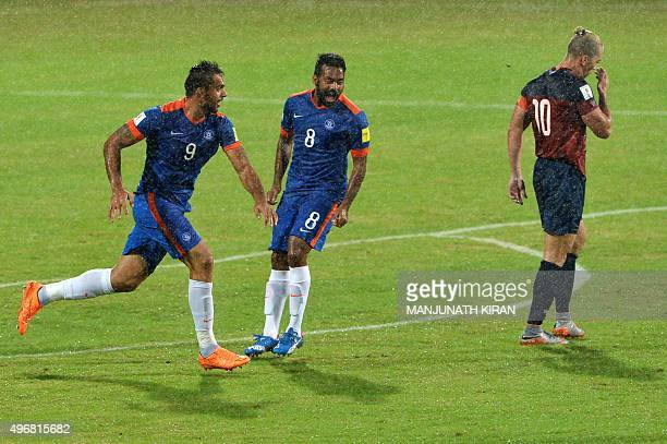 India's forward Robin Singh exults after scoring the first goal against Guam during the the Asia Group D FIFA World Cup 2018 qualifying football...