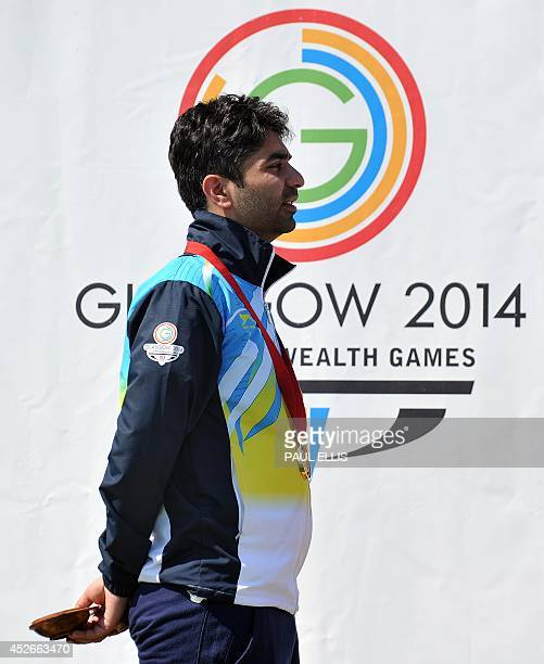 India's gold medalist Abhinav Bindra stands on the podium at the medal ceremony for the men's10m Air Rifle final at the Barry Buddon Shooting Centre...