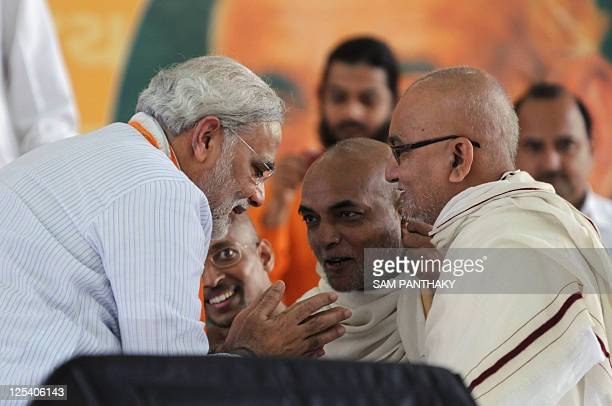 India's Gujarat state Chief Minister Narendra Modi greet religious leaders from the Jain community at the Gujarat University Convention Centre in...