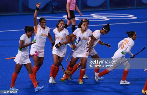 India's Gurjit Kaur celebrates with teammates after scoring against Argentina during their women's semi-final match of the Tokyo 2020 Olympic Games...
