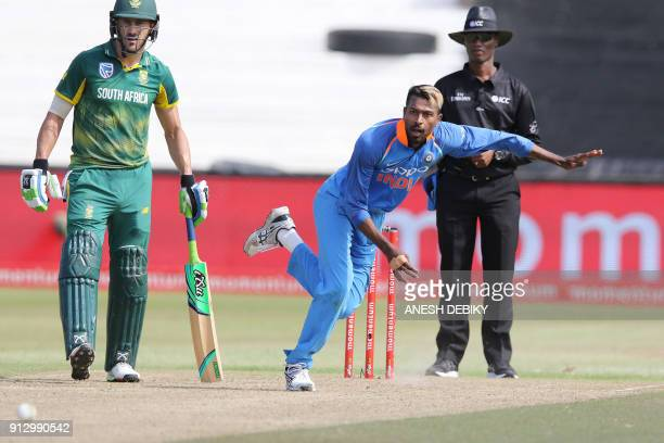 India's Hardik Pandya bowls as South Africa's batsman Faf du Plessis looks on during the first One Day International cricket match between South...