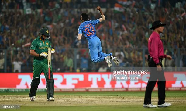 India's Hardik Pandya celebrates after his dismissal of Pakistan's captain Shahid Afridi during the World T20 cricket tournament match between India...