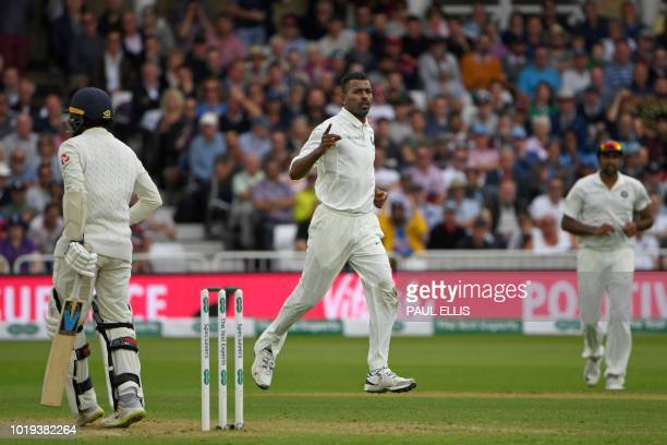 India's Hardik Pandya celebrates after taking the wicket of England's Adil Rashid during play on the second day of the third Test cricket match...