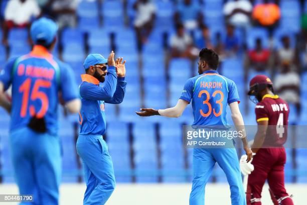 India's Hardik Pandya celebrates with captain Virat Kohli after dismissing West Indies' Kyle Hope during the third One Day International match...