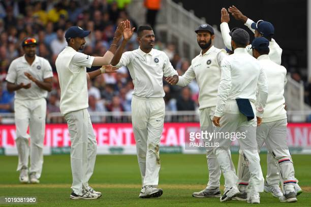 India's Hardik Pandya celebrates with teammates after taking the wicket of England's Adil Rashid during play on the second day of the third Test...