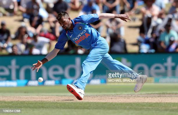 India's Hardik Pandya fields off his own bowling during the third oneday international cricket match between New Zealand and India at Bay Oval in...
