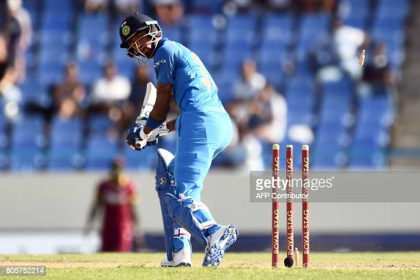 India's Hardik Pandya is bowled off West Indies' captain Jason Holder during the fourth One Day International match between West Indies and India at...
