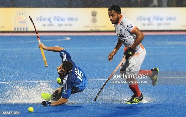 India's Harmanpreet Singh fights for the ball with Argentina's Diego Paz during their semifinals of the Hockey World League Final match between India...