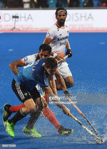 India's Harmanpreet Singh fights for the ball with Argentina's Maico Casella during their semifinals of the Hockey World League Final match between...