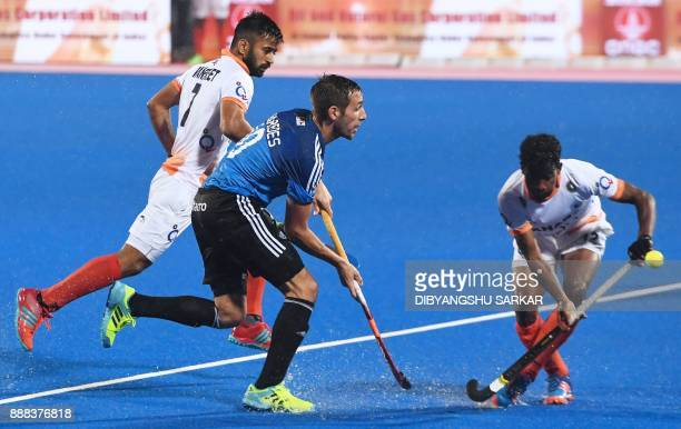 India's Harmanpreet Singh fights for the ball with Argentina's Matias Paredes during their semifinals of the Hockey World League Final match between...