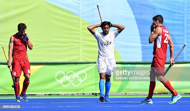 India's Harmanpreet Singh gestures after Belgium's third goal during the men's quarterfinal field hockey Belgium vs India match of the Rio 2016...