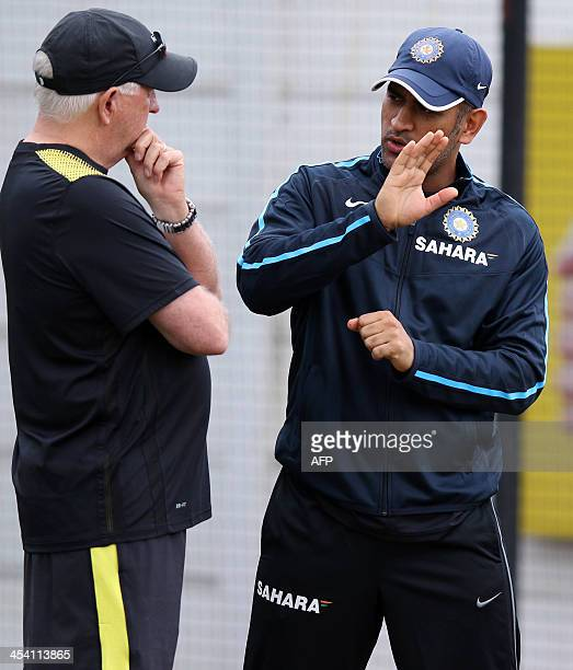 India's Head Coach Duncan Fletcher and Captain Mahendra Singh Dhoni discuss tactics in the nets area during the Indian national cricket team training...