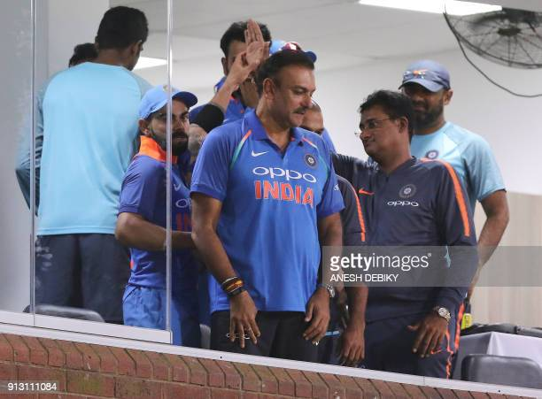 India's head coach Ravi Shastri celebrates with captain Virat Kohli his team's win after the first One Day International cricket match between South...