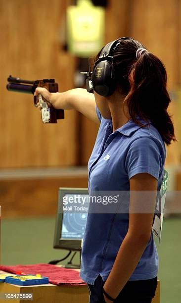 India's Heena Sidhu during women's 10m air pistol singles shooting event of Commonwealth Games at Dr K Singh Shooting Range in New Delhi on October...