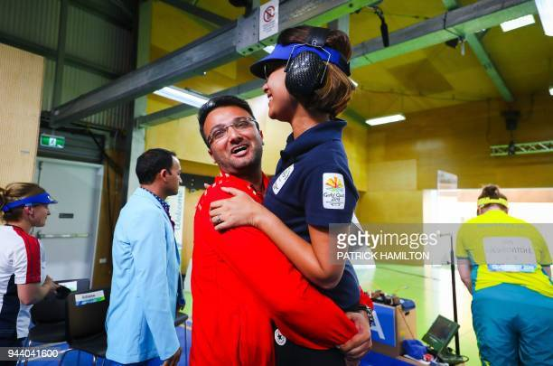 India's Heena Sidhu is hugged by her coach and husband Ronak Pandit following the women's 25m pistol shooting final during the 2018 Gold Coast...