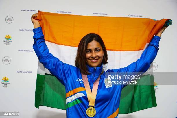 India's Heena Sidhu waves from the podium at the awards ceremony following her victory in the women's 25m pistol shooting during the 2018 Gold Coast...