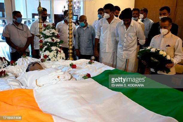 India's High Commissioner to Sri Lanka Gopal Baglay presents a wreath to pay his respects during the funeral of the Ceylon Workers' Congress trade...