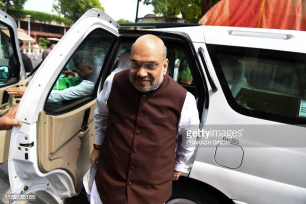 India's Home Minister Amit Shah arrives at the parliament house in New Delhi on August 5 2019 Authorities in Indianadministered Kashmir placed large...