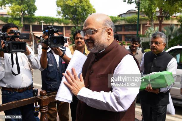 India's Home Minister Amit Shah arrives at the parliament house in New Delhi on August 5, 2019. - Authorities in Indian-administered Kashmir placed...