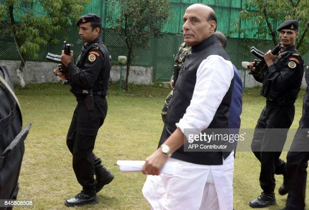 India's Home Minister Rajnath Singh walks before a press conference in Srinagar on September 11 2017 Singh is on a fourday visit to Jammu and Kashmir...