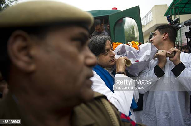 India's Human Resources Minister Shashi Tharoor and relatives and friends carry the body of Tharoor's wife Sunanda Pushkar before her cremation in...