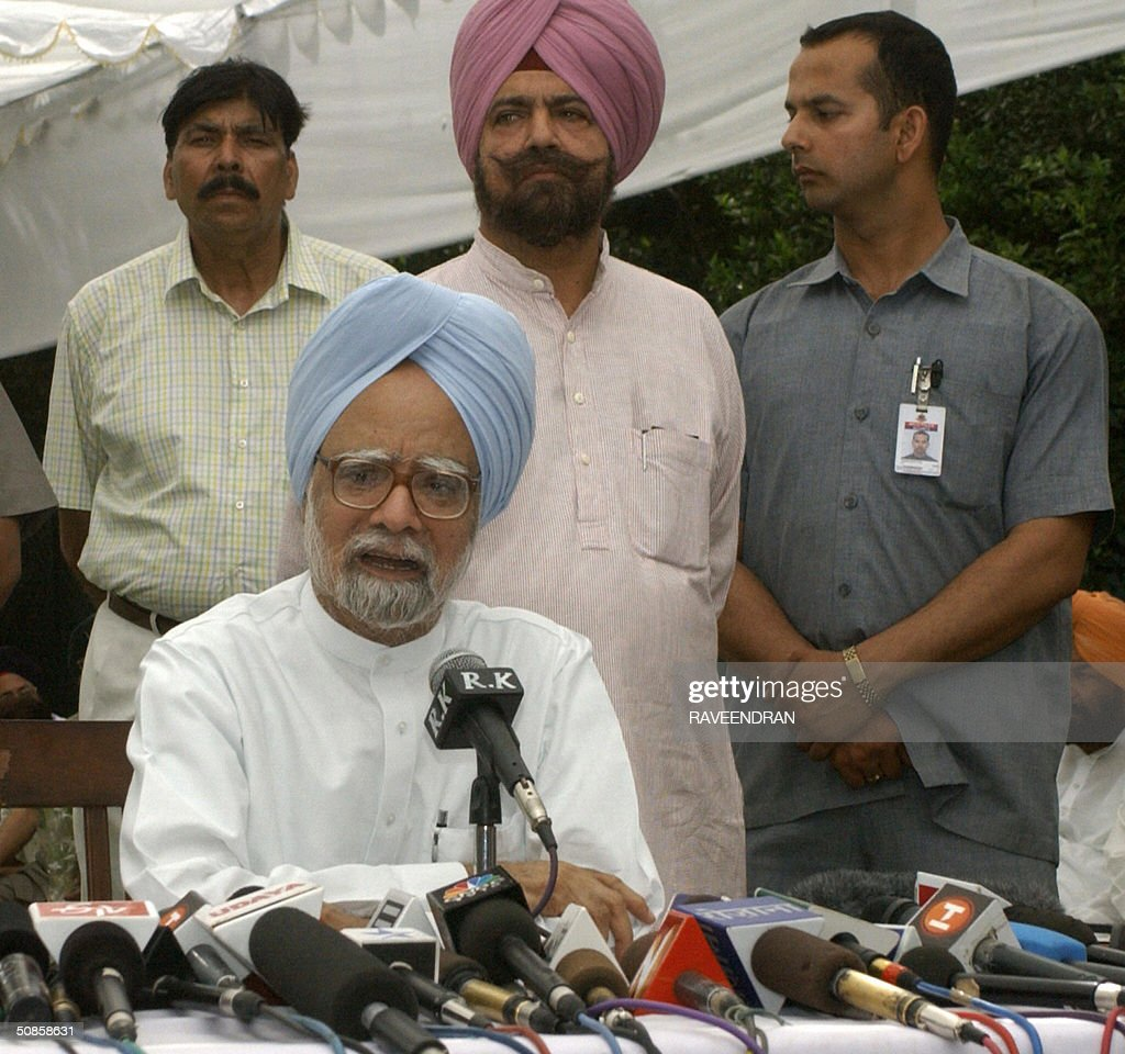 India's incoming prime minister Manmohan Singh (C) addresses a press conference at his residence in New Delhi,20 May 2004. Singh pledged to push forward dialogue with neighbouring Pakistan, saying friction between the rivals should be 'a thing of the past.' and 'We seek the most friendly relations with our neighbours, more so with Pakistan than with any other,'.