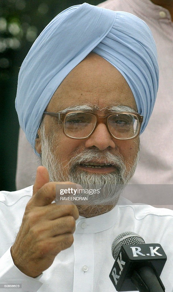 India's incoming prime minister Manmohan Singh gestures as he addresses a press conference at his residence in New Delhi,20 May 2004. Singh pledged to push forward dialogue with neighbouring Pakistan, saying friction between the rivals should be 'a thing of the past.' and 'We seek the most friendly relations with our neighbours, more so with Pakistan than with any other,'.