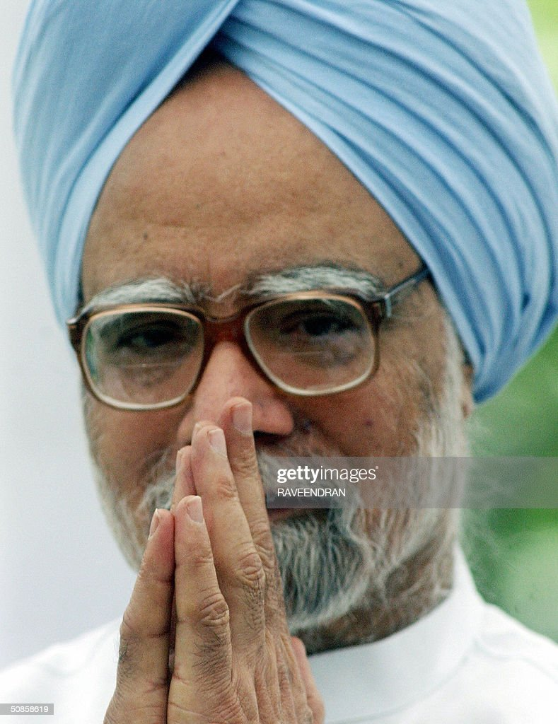 India's incoming prime minister Manmohan Singh offers a traditional Indian 'Namaste' greeting to media representatives prior to addressing a press conference at his residence in New Delhi,20 May 2004. Singh pledged to push forward dialogue with neighbouring Pakistan, saying friction between the rivals should be 'a thing of the past.' and 'We seek the most friendly relations with our neighbours, more so with Pakistan than with any other,'.