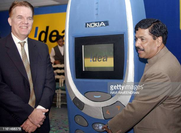 India's Information Technology and Communications Minister Pramod Mahajan launches the Idea Cellular in India as Idea Cellular Limited Chief...