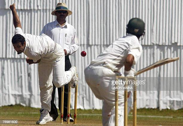 India's Irfan Pathan delivers against Kenya's batsman Tanmay Mishra 06 August 2007 as umpire Rocky D'mello looks on during a threeday match at the...