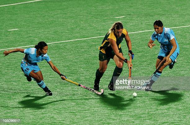 India's Jasjeet Kaur Handa and Chanchan Devi Thokchom fight for the ball with South Africa's Tyrryn Bright during their field hockey match at the...