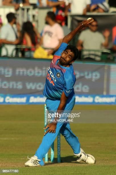 India's Jasprit Bumrah bowls during the Twenty20 International cricket match between Ireland and India at Malahide cricket club in Dublin on June 27...