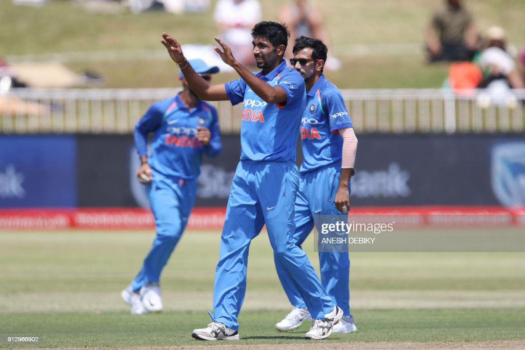 India's Jasprit Bumrah (C) celebrates a wicket during the first One Day International cricket match between South Africa and India at Kingsmead cricket ground on February 1, 2018 in Durban. /