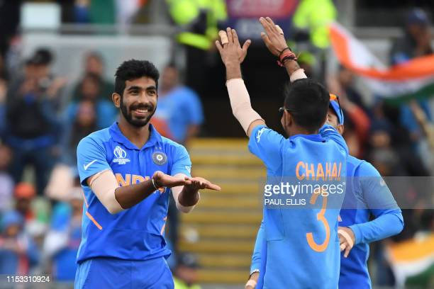 TOPSHOT India's Jasprit Bumrah celebrates the wicket of Bangladesh's Sabbir Rahman for 36 during the 2019 Cricket World Cup group stage match between...
