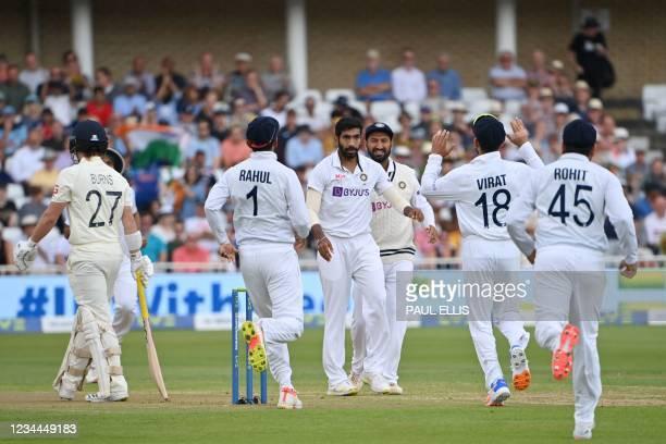 India's Jasprit Bumrah celebrates with team mates after taking the wicket of England's Rory Burns for a duck on the first day of the first cricket...