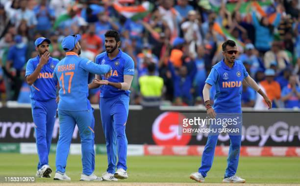 India's Jasprit Bumrah celebrates with teammates after the dismissal of Bangladesh's Sabbir Rahman during the 2019 Cricket World Cup group stage...