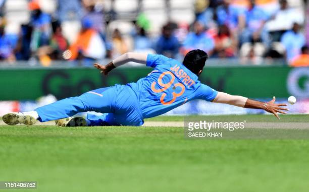 India's Jasprit Bumrah dives to field a ball during the 2019 Cricket World Cup group stage match between India and Afghanistan at the Rose Bowl in...