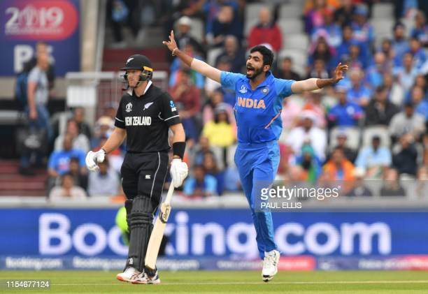 India's Jasprit Bumrah gestures after a delivery as nonstriking batsman New Zealand's Martin Guptill looks on during the 2019 Cricket World Cup first...