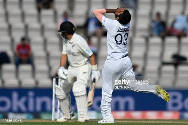 India's Jasprit Bumrah reacts as a teammate drops a catch from a ball played by New Zealand's Ross Taylor on the final day of the ICC World Test...
