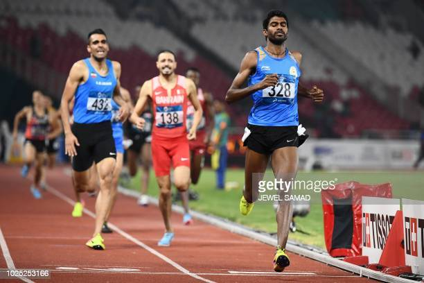 India's Jinson Johnson competes in the final of the men's 1500m athletics event during the 2018 Asian Games in Jakarta on August 30 2018