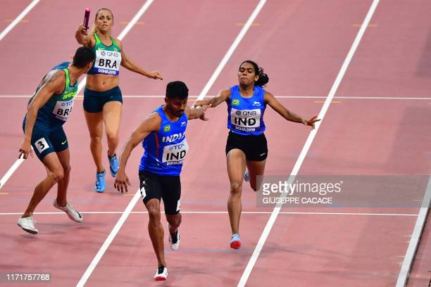 India's Jisna Mathew hands the baton to India's Noah Nirmel Tom in the Mixed 4 x 400m Relay heats at the 2019 IAAF World Athletics Championships at...
